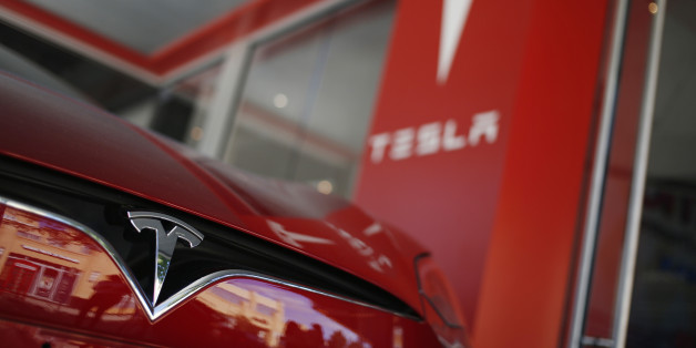A Tesla Motors Inc. electric vehicle sits on display outside a company's store at the Easton Town Center shopping mall in Columbus, Ohio, U.S., on Tuesday, Aug. 23, 2016. The Conference Board is scheduled to release consumer confidence data on Aug. 30. Photographer: Luke Sharrett/Bloomberg via Getty Images