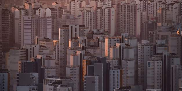 A general view shows apartment buildings and the city skyline at sunrise in Seoul on December 10, 2016.A day after South Korean lawmakers successfully impeached scandal-hit President Park Geun-Hye, hundreds of thousands of people were expected to take to the streets of Seoul for a scheduled protest turned celebration. / AFP / Ed JONES        (Photo credit should read ED JONES/AFP/Getty Images)