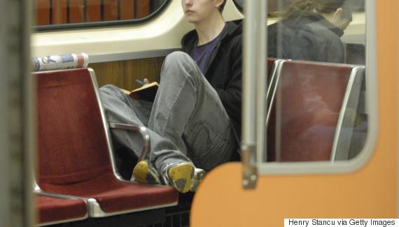 feet on subway seat