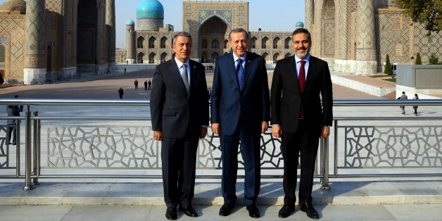 SAMARKAND, UZBEKISTAN - NOVEMBER 18: President of Turkey, Recep Tayyip Erdogan (C), Head Of National Intelligence Organization of Turkey Hakan Fidan (R) and Chief of the General Staff of the Turkish Armed Forces Hulusi Akar (L) pose for a photo as they visit the tomb of Abu Mansur Al Maturidi also know as Imam Maturidi in Samarkand, Uzbekistan on November 18, 2016. Bukhari is a Persian Islamic scholar who was educated in Islamic theology, Qur'anic exegesis, and Islamic jurisprudence and was born in Samarkand and died on 944 A.D.. (Photo by Kayhan Ozer/Anadolu Agency/Getty Images)