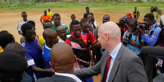 KAMPALA, UGANDA - FEBRUARY 25: FIFA President Gianni Infantino speaks with young footballers during his visit in Kampala, Uganda on February 25, 2017.  (Photo by Lubowa Abubaker/Anadolu Agency/Getty Images)