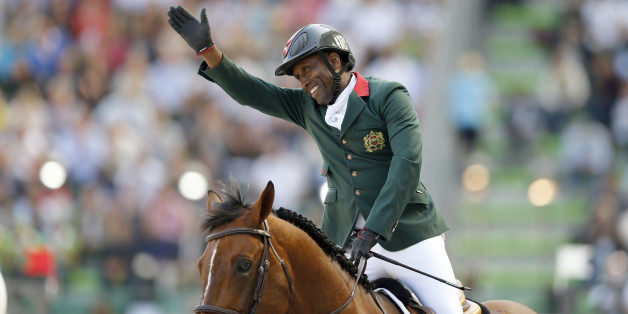 Abdelkebir Ouaddar of Morocco riding Quickly De Kreisker celebrates during the individual second round event of the Jumping Competition at the World Equestrian Games in Caen, September 4, 2014. REUTERS/Regis Duvignau (FRANCE - Tags: SPORT EQUESTRIANISM ANIMALS)