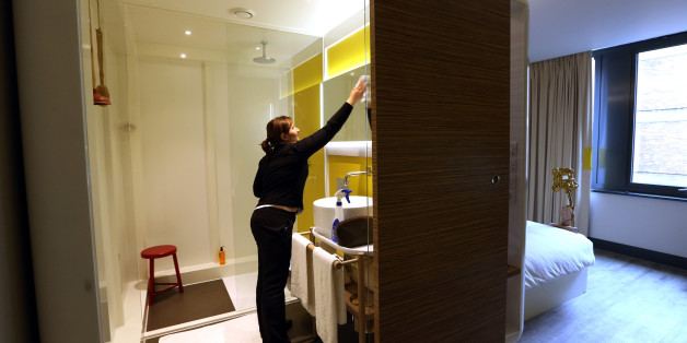 A chambermaid cleans the bathroom of a room at the Qbic Hotel London City, operated by Qbic Hotels, in London, U.K., on Tuesday, Oct. 22, 2013. U.K. retail sales rose more than economists forecast in September, rebounding from a slump the previous month. Photographer: Chris Ratcliffe/Bloomberg via Getty Images