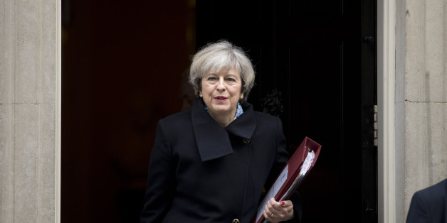 British Prime Minister Theresa May leaves 10 Downing Street for the weekly Prime Minister's Questions session at the House of Commons in central London on March 1, 2017.