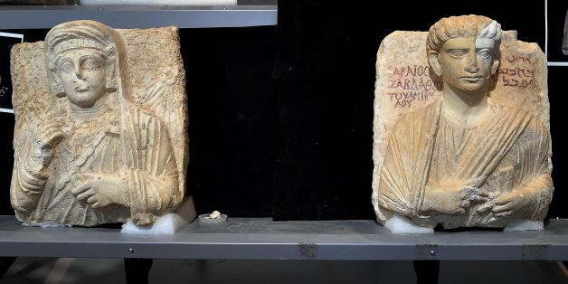 A picture taken on February 16, 2017 shows two funeral reliefs from Palmyra archeological site that will be restored, at the Higher Institute of Conservation and Restoration (ISCR - Istituto Superiore per la Conservazione ed il Restauro), in Rome.The busts of a man and a woman, dated from the 2nd and 3rd century AD and destroyed by the Islamic State group (IS), have been entrusted to the care of the technical and restorers of the ISCR in Rome. By the end of this month, they will be returned to t