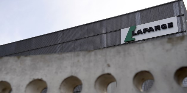 A picture shows the logo on a plant of French cement company Lafarge on April 7, 2014 in Paris. Swiss cement group Holcim and French rival Lafarge are merging to create the biggest global concrete group worth 40.0 billion euros, with an eye to booming construction in emerging markets, the new group LafargeHolcim announced on April 7. The deal, a major event in the global construction industry described in a joint statement as 'a merger of equals', will be based on the offer of one Holcim share f