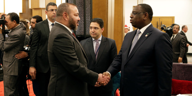King Mohammed VI of Morocco (L) shakes hand with President of Senegal Macky Sall at the opening of the Africa Action Summit, on the sidelines of the UN Climate Change Conference 2016 (COP22) in Marrakech, Morocco November 16, 2016. REUTERS/Youssef Boudlal