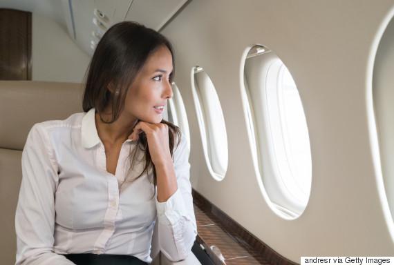 ethnic woman plane