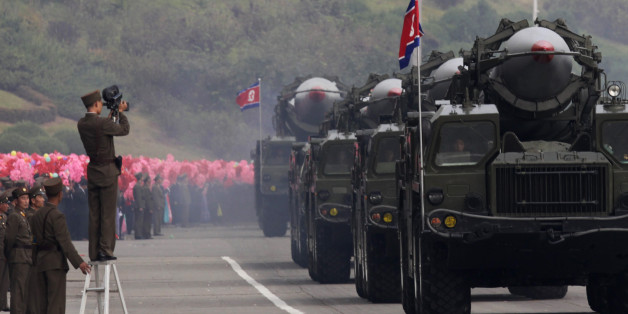 A North Korean soldier films military vehicles carrying missiles during a parade to commemorate the 65th anniversary of founding of the Workers' Party of Korea in Pyongyang October 10, 2010. REUTERS/Petar Kujundzic  (NORTH KOREA - Tags: MILITARY POLITICS ANNIVERSARY)