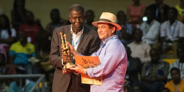 OUAGADOUGOU, BURKINA FASO - MARCH 05: Algerian film director Lotfi Bouchouchi (R) holds the award after receiving the  during the award ceremony on the last day of 25th Panafrican FESPACO Film and Television Festival at Dr Issoufou Joseph Conombo Stadium in capital Ouagadougou, Burkina Faso on March 05, 2017. (Photo by Olympia de Maismont/Anadolu Agency/Getty Images)