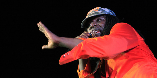 Ivorian reggae singer Alpha Blondy performs during the closing ceremony of the Market for African Performing Arts (MASA) Festival at the Culture Palace in Abidjan March 8, 2014. Picture taken March 8, 2014.  REUTERS/Thierry Gouegnon (IVORY COAST - Tags: SOCIETY ENTERTAINMENT)