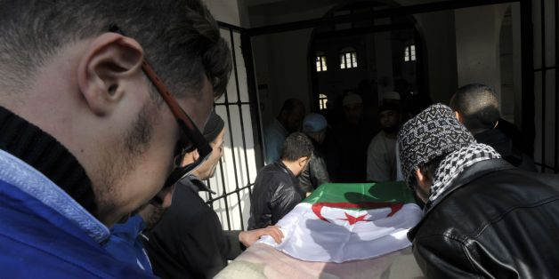 Relatives and friends carry the body of British-Algerian journalist Mohamed Tamalt during his funeral, on December 12, 2016 in Algiers.Mohamed Tamalt died on December 11, 2016 after having staged a hunger strike to protest a two-year jail term for offending Algeria's president in a poem posted online, his lawyer said. / AFP / RYAD KRAMDI        (Photo credit should read RYAD KRAMDI/AFP/Getty Images)