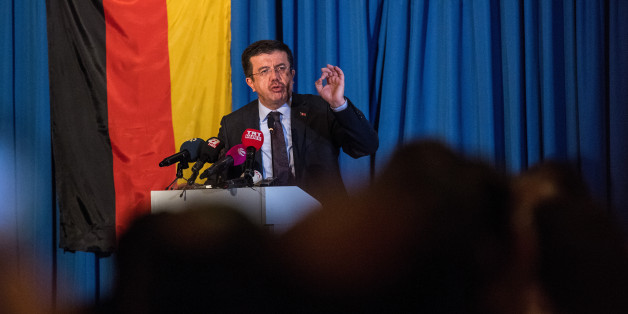 COLOGNE, GERMANY - MARCH 05: Turkish Economy Minister Nihat Zeybekci talks to Turks attend an event organized by the Turkish AKP, the political party of Turkish President Recep Tayyip Erdogan, on March 5, 2017 in Cologne, Germany. Zeybekci had sought to speak at a rally in Cologne in support of a 'yes' vote in the upcoming referendum in Turkey, though local authorities intervened and blocked the initial venue. Turkish government officials, at the invitation of an organization called the Union of