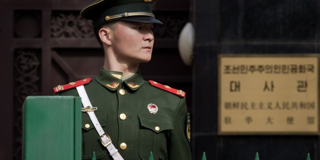 A paramilitary police officer stands guard in front of the North Korean embassy in Beijing on March 6, 2017.  
