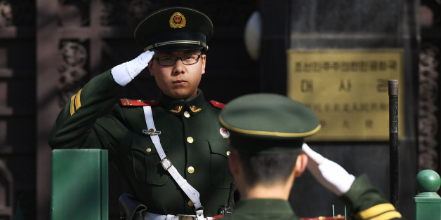 Chinese paramilitary police officers salute each other at the entrance of the North Korean embassy in Beijing on March 7, 2017. North Korea's ambassador to Malaysia Kang Chol is believed to be in the Bejing embassy after he was expelled from Malaysia in a deepening diplomatic dispute over the assassination of the half brother of Pyongyang's leader. / AFP PHOTO / GREG BAKER        (Photo credit should read GREG BAKER/AFP/Getty Images)