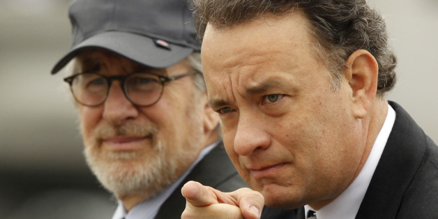 """Executive Producers of the mini series """"The Pacific"""", director Steven Spielberg (L) and actor Tom Hanks participate in a tribute to veterans at the World War II Memorial on the Washington Mall, March 11, 2010. The pair were joined by 250 World War II veterans in a tribute to those who served in the Pacific theater of World War II, before the March 14 premiere of the 10-part HBO miniseries """"The Pacific"""".    REUTERS/Jason Reed    (UNITED STATES - Tags: ENTERTAINMENT IMAGES OF THE DAY)"""