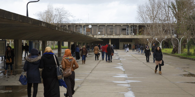 ALGIERS, ALGERIA - JANUARY 25: Students walk across campus of University of Sciences and Technology Houari Boumediene in January 25, 2015 in Algiers, Algeria. The university buildings were designed by architect Oscar Niemeyer (Photo by Thomas Trutschel/Photothek via Getty Images)