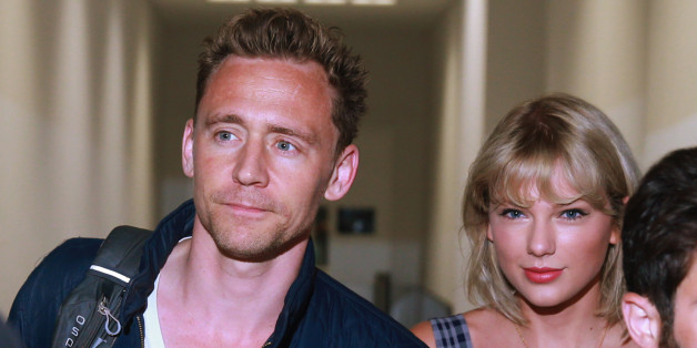 SYDNEY, AUSTRALIA - JULY 8: (EUROPE AND AUSTRALASIA OUT) Actor Tom Hiddleston and singer Taylor Swift arrive at Sydney International Airport in Sydney, New South Wales. The couple are then believed to have got a connecting flight to the Gold Coast. (Photo by Cameron Richardson/Newspix/Getty Images)