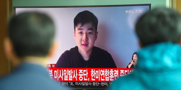 South Koreans watch a television news showing a video footage of a man who claims he is Kim Han-Sol, a nephew of North Korea's leader Kim Jong-Un, at a railway station in Seoul on March 8, 2017.The video of a man describing himself as the son of assassinated North Korean exile Kim Jong-Nam emerged on March 8, apparently the first time a family member has spoken about the killing. / AFP PHOTO / JUNG Yeon-Je        (Photo credit should read JUNG YEON-JE/AFP/Getty Images)