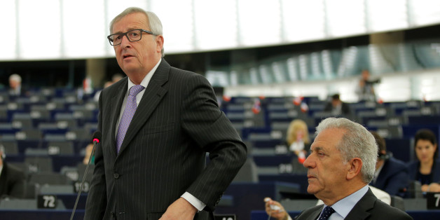 European Commission President Jean-Claude Juncker (L) addresses the European Parliament in Strasbourg, France, July 5, 2016. Rights is European Commissioner for Migration and Home Affairs Dimitris Avramopoulos.  REUTERS/Vincent Kessler