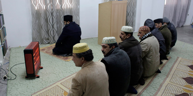 ATHENS, GREECE - FEBRUARY 5: Muslims pray at a Ahmadiyya Muslim Community makeshift mosque that was converted from an apartment on February 5, 2017 in Athens, Greece. Since the end of the Ottoman rule, Athens is the only European capital city without an official mosque. It is estimated there are about one hundred makeshift mosques in the Greek capital. (Photo by Milos Bicanski/Getty Images)