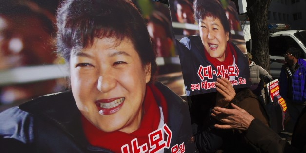 Pro-government activists hold a portraits of South Korean President Park Geun-Hye outside the Constitutional Court in Seoul on February 27, 2017 as the court holds its final hearing in the impeachment trial of Park Geun-Hye. / AFP / JUNG Yeon-Je        (Photo credit should read JUNG YEON-JE/AFP/Getty Images)