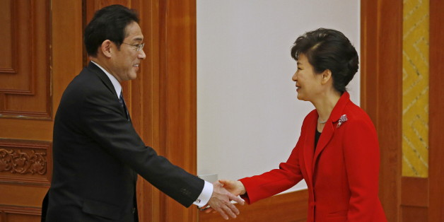 South Korea President Park Geun-hye (R) shakes hands with  Japanese Foreign Minister Fumio Kishida during their meeting at the Presidential Blue House in Seoul March 21, 2015. The foreign ministers of South Korea, Japan and China on Saturday hold their first meeting in three years, in a bid to warm frosty ties and restore a regular three-way summit of their leaders, stalled because of tensions over history and territory.  REUTERS/Kim Hong-Ji