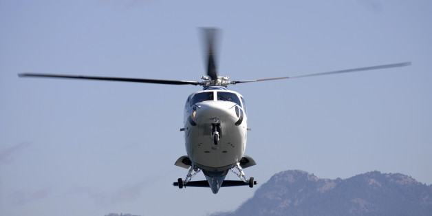 A medivac helicopter on final to land at an accident scene