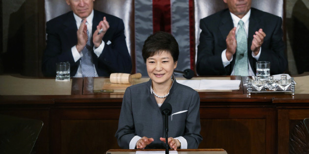 FILE PHOTO: South Korea's President Park Geun-hye is applauded by U.S. Vice President Joe Biden (L) and House Speaker John Boehner (R-OH) as she addresses a joint meeting of Congress in Washington May 8, 2013.  REUTERS/Gary Cameron/File Photo