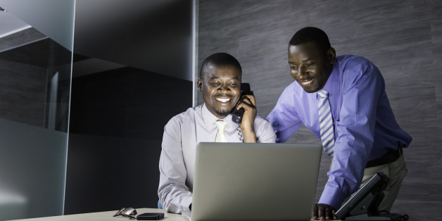 African businessmen working together on an assignment. Cape Town, South Africa.