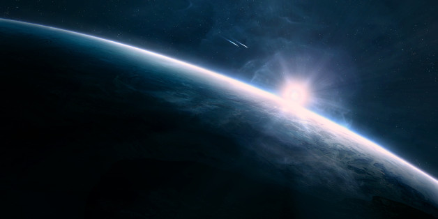 Digitally created scene of a sunrise in space