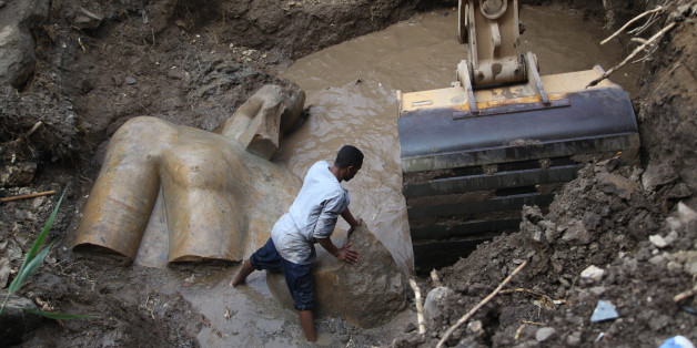 CAIRO, March 9, 2017:   An Egyptian worker prepares to lift parts of a statue at the site of a new archeological discovery at Souq Al-Khamis district in Al-Matareya area, Cairo, Egypt on March 9, 2017. According to the Ministry of Antiquities, two 19th dynasty royal statues were found in parts in the vicinity of King Ramses II temple in ancient Heliopolis (Oun) Sun Temples by a German-Egyptian archeological mission. (Xinhua/Ahmed Gomaa via Getty Images)