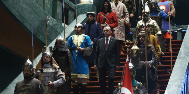 Turkey's President Tayyip Erdogan walks down the stairs in between soldiers, wearing traditional army uniforms from the Ottoman Empire, as he arrives for a welcoming ceremony for Palestinian President Mahmoud Abbas (not pictured) at the Presidential Palace in Ankara January 12, 2015. REUTERS/Adem Altan/Pool (TURKEY - Tags: POLITICS)