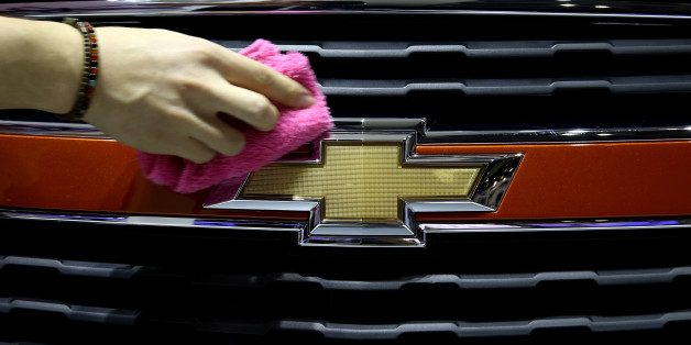An event staff member wipes a General Motors Corp. (GM) Chevrolet Trax vehicle during the press day of the 2014 Busan International Motor Show in Busan, South Korea, on Thursday, May 29, 2014. The Motor Show runs until June 8. Photographer: SeongJoon Cho/Bloomberg via Getty Images