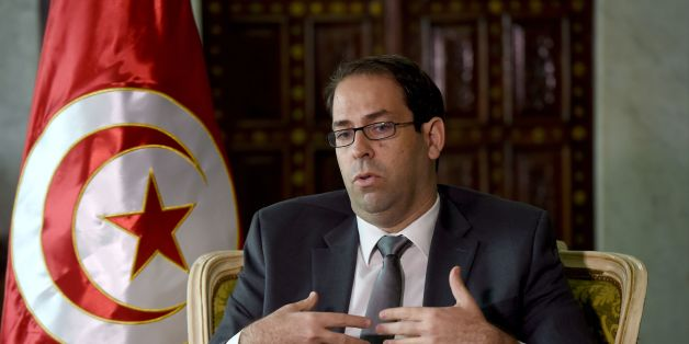 Tunisian Prime Minister Youssef Chahed speaks with AFP journalists on November 8, 2016 in Tunis.