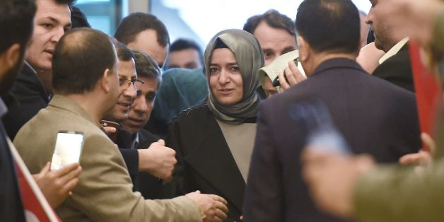 Turkey's Family Minister Fatma Betul Sayan Kaya (C) arrives at the Ataturk International airport on March 12, 2017 in Istanbul. Turkey's Family Minister Fatma Betul Sayan Kaya was back in Istanbul on March 12 after being expelled from the Netherlands and escorted back to Germany by Dutch police, condemning The Hague's 'ugly' treatment. / AFP PHOTO / OZAN KOSE        (Photo credit should read OZAN KOSE/AFP/Getty Images)