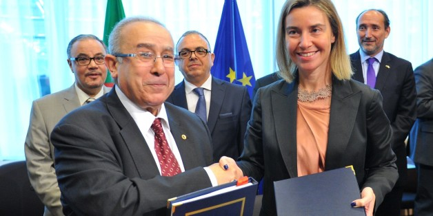 BRUSSELS, BELGIUM - JUNE 04: Algerian Foreign Minister Ramtane Lamamra (L) and High Representative of the European Union for Foreign Affairs and Security Policy, Federica Mogherini (R) shake hands after signing a bilateral agreement following the Algeria-EU Association Council Meeting in Brussels, Belgium on June 4, 2015. (Photo by Dursun Aydemir/Anadolu Agency/Getty Images)