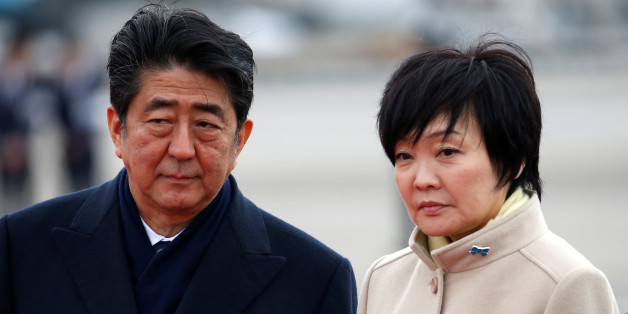 Japan's Prime Minister Shinzo Abe (L) and his wife Akie send off Emperor Akihito and Empress Michiko boarding a special flight for their visit to the Vietnam and Thailand, at Haneda Airport in Tokyo, Japan February 28, 2017. REUTERS/Issei Kato