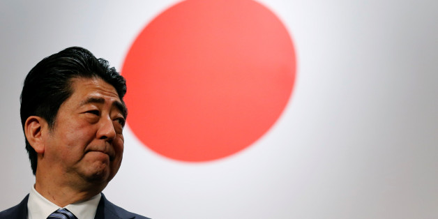 Japan's Prime Minister Shinzo Abe stands in front of Japan's national flag after his ruling Liberal Democratic Party's (LDP) annual party convention in Tokyo, Japan, March 5, 2017.  REUTERS/Toru Hanai