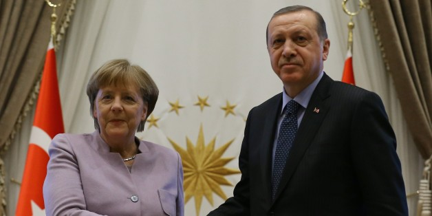 ANKARA, TURKEY - FEBRUARY 2 : Turkish President Recep Tayyip Erdogan (R) and German Chancellor Angela Merkel (L) shake hands during a press conference after their meeting at the Presidential Complex in Ankara, Turkey on February 2, 2017. (Photo by Halil Sarkaya/Anadolu Agency/Getty Images)