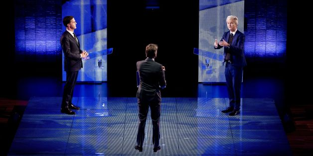 Netherlands' far-right politician Geert Wilders (R) of the PVV party gestures while during a debate with Netherlands' prime minister Mark Rutte of the VVD Liberal party on March 13, 2017 in Rotterdam, prior to March 15 Dutch national elections. / AFP PHOTO / ANP / Remko de Waal / Netherlands OUT        (Photo credit should read REMKO DE WAAL/AFP/Getty Images)