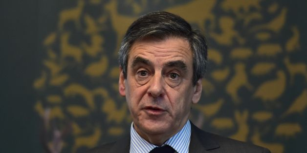 French presidential election candidate for the right-wing Les Republicains (LR) party Francois Fillon (C) delivers a speech during a meeting of the General Assembly of the French National Federation of Hunters on March 14, 2017 in Paris.  France's rightwing presidential candidate Francois Fillon has been charged with several offences over a fake jobs scandal, including for misuse of public funds, his lawyer told AFP on March 14, 2017.  / AFP PHOTO / CHRISTOPHE ARCHAMBAULT        (Photo credit should read CHRISTOPHE ARCHAMBAULT/AFP/Getty Images)