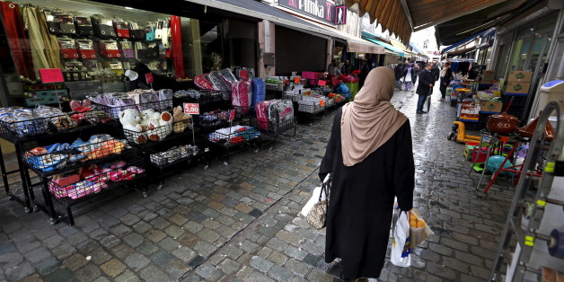 A woman walks in a street in the suburb of Molenbeek, after security was tightened in Belgium following the fatal attacks in Paris on Friday, in Brussels, Belgium, November 17, 2015. REUTERS/Yves Herman