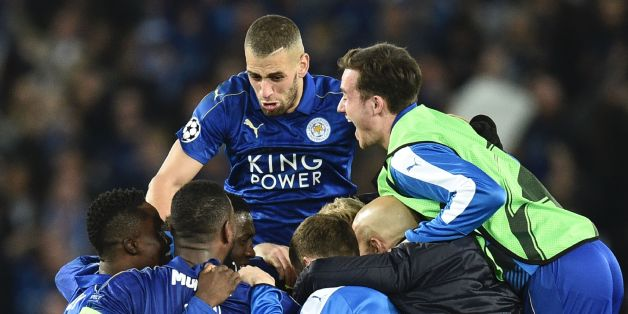 Leicester City's Algerian striker Islam Slimani (CL top) jumps in to celebrate with his Leicester teammates after their victory at the end of the UEFA Champions League round of 16 second leg football match between Leicester City and Sevilla at the King Power Stadium on March 14, 2017. / AFP PHOTO / Oli SCARFF        (Photo credit should read OLI SCARFF/AFP/Getty Images)