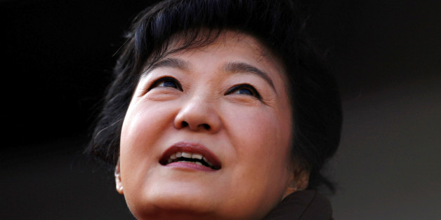FILE PHOTO: South Korea's presidential candidate Park Geun-hye of the ruling Saenuri Party attends her election campaign rally in Suwon, about 46 km (29 miles) south of Seoul December 17, 2012.     REUTERS/Kim Hong-Ji/File Photo          TPX IMAGES OF THE DAY