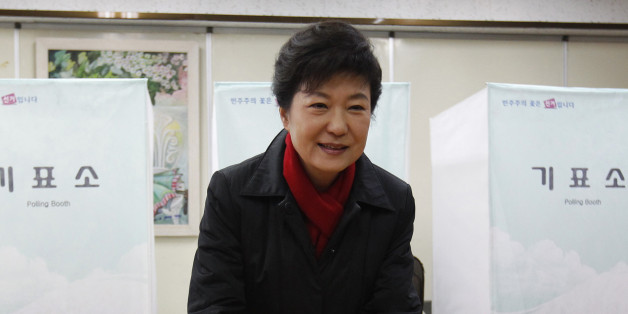South Korea's presidential candidate Park Geun-hye of conservative and right wing ruling Saenuri Party casts her ballot at a polling station in Seoul December 19, 2012. South Koreans vote for a new president on Wednesday against a backdrop of a hostile North Korea and a slowing economy, in a battle between conservative candidate Park, 60, daughter of former military ruler Park Chung-hee and Moon Jae-in of the Democratic United Party, who was jailed by her father decades ago for political activis