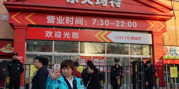 BEIJING, CHINA - MARCH 13: Citizens walk past a supermarket of South Korea's Lotte Group, which is shut down for violating fire safety rules on March 13, 2017 in Beijing, China. Lotte has faced growing opposition in China since signing a deal to provide land to host the Terminal High-Altitude Area Defense (THAAD) system. And dozens of Lotte stores have been closed in China. (Photo by VCG/VCG via Getty Images)