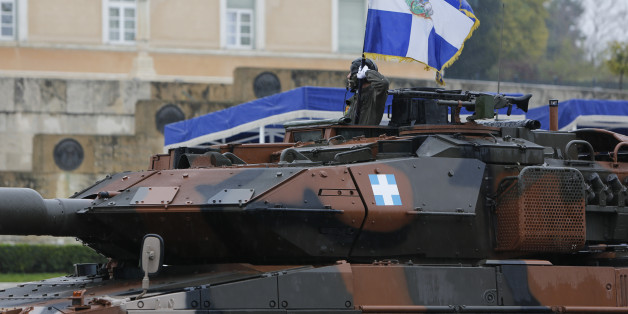 SYNTAGMA SQUARE, ATHENS, ATTICA, GREECE - 2015/03/25: A soldier in a German Leopard 2 Main Battle Tank holds an Army regimental war flag during the military parade in Athens. A military parade was held in Athens despite heavy rain, to celebrate the 194th Greek Independence Day. The day celebrates the start of the Greek War of Independence in 1821, which lead to the independence of Greece from the Ottoman Empire. (Photo by Michael Debets/Pacific Press/LightRocket via Getty Images)