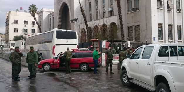 Syrian security forces cordon off the area following a reported suicide bombing at the old palace of justice building in Damascus on March 15, 2017.A suicide bomber attacked the courthouse in the centre of the Syrian capital, killing at least 25 people and wounding others, state media reported. / AFP PHOTO / STRINGER        (Photo credit should read STRINGER/AFP/Getty Images)