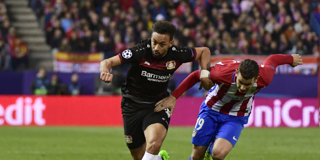 Leverkusen's midfielder Karim Bellarabi (L) vies with Atletico Madrid's French defender Lucas Hernadez during the UEFA Champions League round of 16 second leg football match Club Atletico de Madrid vs Bayer Leverkusen at the Vicente Calderon stadium in Madrid on March 15, 2017. / AFP PHOTO / PIERRE-PHILIPPE MARCOU        (Photo credit should read PIERRE-PHILIPPE MARCOU/AFP/Getty Images)